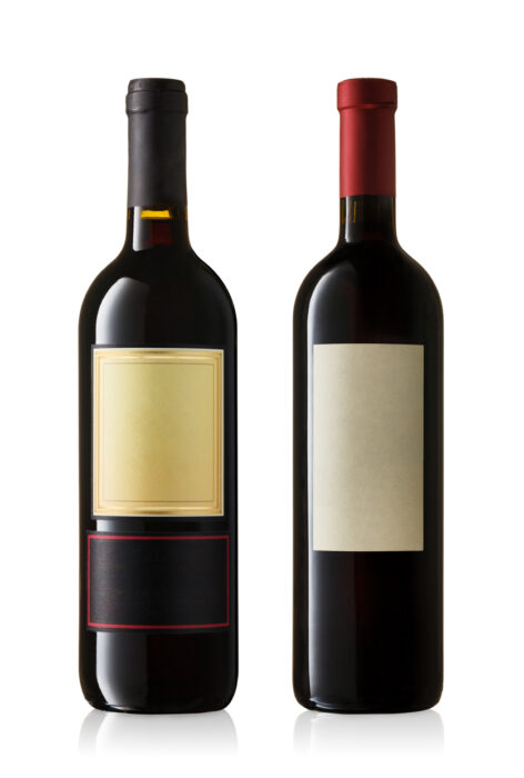 Collection of bottles of red wine on white background. Classic look.